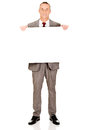 Full length businessman holding empty banner Royalty Free Stock Photo