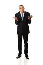 Full length businessman making undecided gesture Royalty Free Stock Photo
