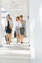 Full-length of businesswomen walking at office hallway Royalty Free Stock Photo
