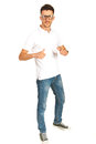 Full length of casual man in white t shirt and jeans showing to him isolated on white background Stock Photo