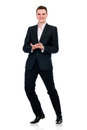 Full length of a cheerful business man standing Stock Images