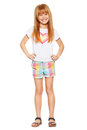 Full length a cheerful little girl with red hair in shorts and a T-shirt; isolated on the white
