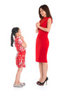 Full length chinese parent and child greeting to each other happy new year in traditional cheongsam isolated on Royalty Free Stock Photography