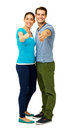 Full length of couple showing thumbs up sign portrait happy over white background vertical shot Royalty Free Stock Photo