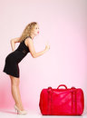 Full length elegant lady in voyage traveler woman with old red bag of young suitcase luggage on pink background travel theme Stock Image