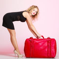 Full length elegant lady in voyage traveler woman with old red bag of young suitcase luggage on pink background travel theme Stock Photography
