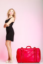 Full length elegant lady in voyage traveler woman with old red bag of young suitcase luggage on pink background travel theme Royalty Free Stock Images