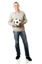 Full length happy mature man with a soccer ball Royalty Free Stock Photo