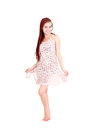Full length of a happy young lady standing white background Royalty Free Stock Image
