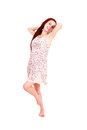 Full length of a happy young lady standing white background Stock Image