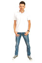 Full length of man in white t shirt and jeans isolated on background Stock Photography
