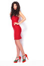Full length picture of a hot young lady standing on white studio background Royalty Free Stock Image