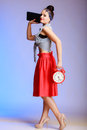 Full length pin-up girl sexy woman with clock going on a date. Stock Photo