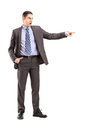 Full length portrait angry businessman pointing his finger white background Royalty Free Stock Photo