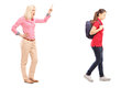 Full length portrait of angry mother yelling at her daughter isolated on white background Royalty Free Stock Photo
