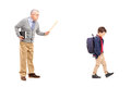 Full length portrait of an angry teacher shouting at a little sc schoolboy isolated on white background Stock Photo