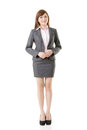 Full length portrait asian business woman wear skirt suit isolated white background Stock Photos