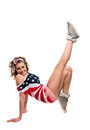 Full length portrait beautiful young funny american patriotic girl wearing colorful pink blue head band red shorts off shoulder Stock Photo