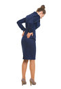 Full length portrait of business woman having back pain high resolution photo Royalty Free Stock Images