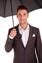 Full length portrait of businessman with opened umbrella Royalty Free Stock Images