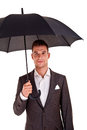 Full length portrait of businessman with opened umbrella Stock Photography
