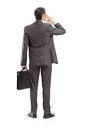 Full length portrait of a businessman thinking shot from behind isolated against white background Royalty Free Stock Photo