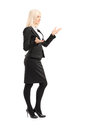 Full length portrait of a businesswoman gesturing with hands standing in profile isolated on white background Stock Photo