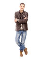 Full length portrait of a casual guy posing isolated on white background Royalty Free Stock Images