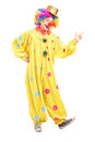 Full length portrait of a cheerful clown in a yellow costume Stock Photos