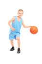 Full length portrait of a child playing with a basketball isolated against white background Stock Image