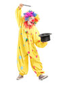 Full length portrait of a circus clown performing a magic trick Royalty Free Stock Photos