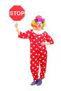 Full length portrait of a clown holding a stop sign against white background Royalty Free Stock Photography