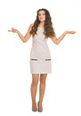 Full length portrait of clueless woman shrugs Royalty Free Stock Photo