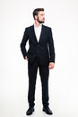 Full length portrait of a confident businessman looking away