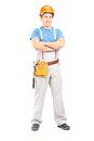 Full length portrait of a confident repairman in a uniform isolated on white background Royalty Free Stock Images
