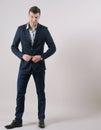 Full length portrait of confident smiling businessman standing i