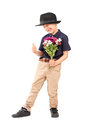 Full length portrait of a cute little boy with a hat holding bun bunch flowers isolated on white background Stock Images
