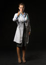 Full length portrait of doctor woman threatening with finger isolated on black Stock Photo