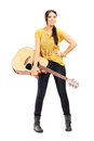 Full length portrait of a female musician holding an acoustic gu guitar isolated on white background Royalty Free Stock Photos