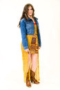 Full length portrait female teen young girl blue jean jacket and yellow print short skirt brown cowboy boots Royalty Free Stock Photos