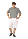 Full length portrait of a fitness man in white shorts isolated Royalty Free Stock Photo