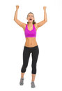 Full length portrait of fitness young woman rejoicing success Royalty Free Stock Image