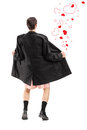 Full length portrait of a flasher in a coat and hearts around him isolated on white background Royalty Free Stock Image