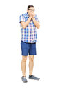 Full length portrait of a frightened young man looking isolated on white background Royalty Free Stock Photography