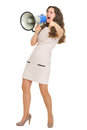 Full length portrait of girl shouting in megaphone Royalty Free Stock Photos