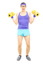 Full length portrait of a guy with glasses exercising with dumbb dumbbells isolated on white background Stock Image