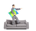 Full length portrait of guy in pajamas sleepwalking on sofa isolated white background Stock Photos