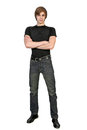 Full length portrait of handsome young man in black clothes standing on white background Royalty Free Stock Photography