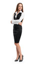 Full length portrait of a happy business woman standing isolated over white background Royalty Free Stock Image