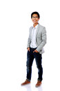 Full length portrait of happy fashion asian man Royalty Free Stock Photo